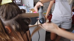 Create naturally curly tresses using curling hair straightening Stock Footage