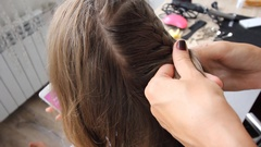 Weaving of hair on the head to the spit the French knot Stock Footage