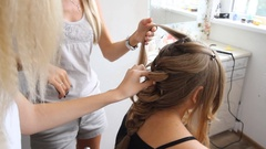 Blonde Girl Braids Her Friend's Hair So They Can Match Stock Footage
