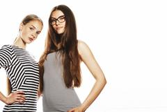 Two young workers isolated on white, same dresses in strip Stock Photos
