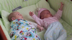 Twins baby girl and boy Stock Footage