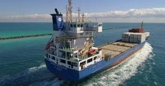 Aerial footage of the Caribe Navigator cargo ship departing Miami Beach Stock Footage