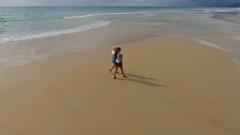Two women walking on tropical beach in Phuket Stock Footage