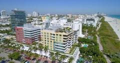 Miami Beach midrise condominiums aerial tour Stock Footage