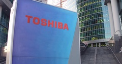 Street signage board with Toshiba Corporation logo. Modern office center Stock Footage