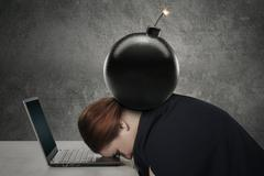 Young woman sleeping on laptop with bomb Stock Photos