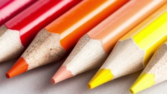 Close-up video of colored pencils lying in a row on a white table Stock Footage