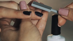 Woman manicurist hand using magnet on customer nail polish in beauty shop Stock Footage