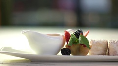 Long plate with dessert. Stock Footage