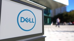 Street signage board with Dell Inc. logo. Blurred office center and walking Stock Footage