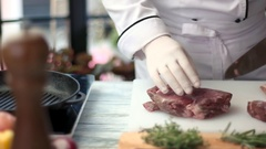 Meat and knife in hands. Stock Footage