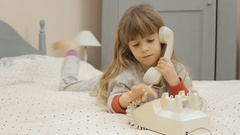 Little girl bed rotary phone call Stock Footage