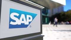 Street signage board with SAP SE logo. Blurred office center and walking people Stock Footage