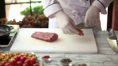 Chef cutting raw meat. Stock Footage