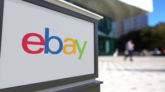 Street signage board with eBay Inc. logo. Blurred office center and walking Stock Footage
