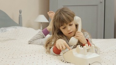 Little girl bed rotary phone talk Stock Footage