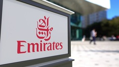Street signage board with Emirates Airline logo. Blurred office center and Stock Footage