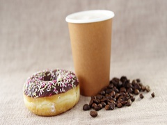 Disposable coffee cup and chocolate doughnut and coffee bean with sprinkles Stock Footage