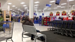 Motion of people shopping food and making phone call inside Walmart store Stock Footage