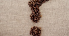 Disposable cup and coffee question mark with coffee beans Stock Footage