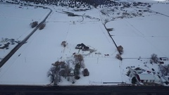Aerial winter snow rural farm house field HD Stock Footage