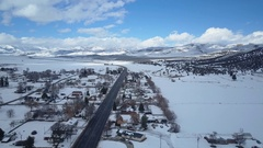 Aerial winter mountain valley rural town Main Street 4K Stock Footage