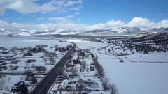Aerial winter mountain valley rural town Main Street away 4K Stock Footage