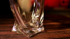 Soft drink being poured into glass with ice cubes Stock Footage
