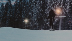 Evening. lighted ski trail. Skiers and snowboarders Stock Footage