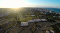 Tilled agricultural fields and vegetable greenhouses in Cyprus, aerial view Stock Footage
