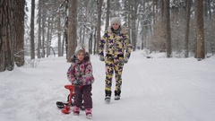 Happy family of mother and little daughter playing together in winter nature Stock Footage