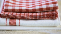 Dish towel on a wood background. Stock Footage