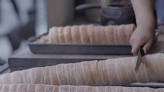 Trdelnik bakery on the street market in Prague, Czech Republic. Stock Footage