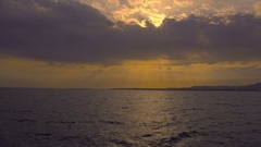 The picturesque sunset on the background of the sea. Wide angle Stock Footage