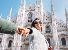 Mother with son take with hands and run together to Duomo di Milano Stock Photos