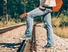 Close up image man legs in sneakers on railways Stock Photos