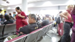 People waiting and walking inside the gate of airport Stock Footage
