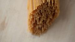 Uncooked spaghetti pasta on kitchen table. Stock Footage