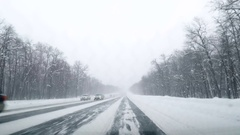 Driving POV on snowy country road. Winter Snow Mountain Road Driving. Fores.. Stock Footage