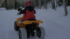 Boy stuck in the snow on his 4wheeler Stock Footage