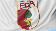 Close-up of waving flag with FC Augsburg football club logo, seamless loop, blue Stock Footage