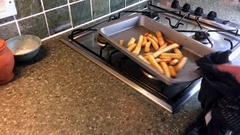 Oven chips fries being shaken in dish Stock Footage