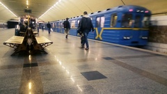 Underground train leaving metro station, people travel by urban public transport Arkistovideo