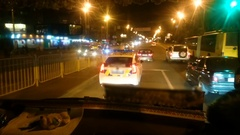 Police patrol car driving night city street, law enforcers on duty, public order Stock Footage