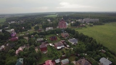 Flying over Lukino Village with Cathedral of Ascension Stock Footage