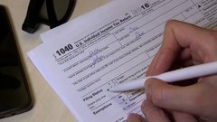 A Woman Is Checking The Box In The US Individual Income Tax Return Form 1040 Stock Footage