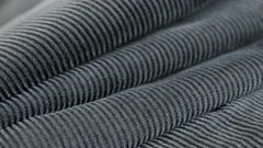 Panning on dark blue twisted fibers of cotton corduroy Stock Footage