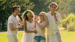 Excited friends sincerely smiling, enjoying summer Holi festival, slow motion Stock Footage