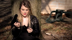 Female Secret Agent hides behind tree with gun V4   Action Movie Shots Stock Footage