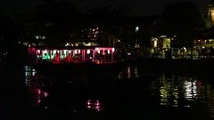 Night walk along the river in a boat with the lanterns in Hoi An Stock Footage